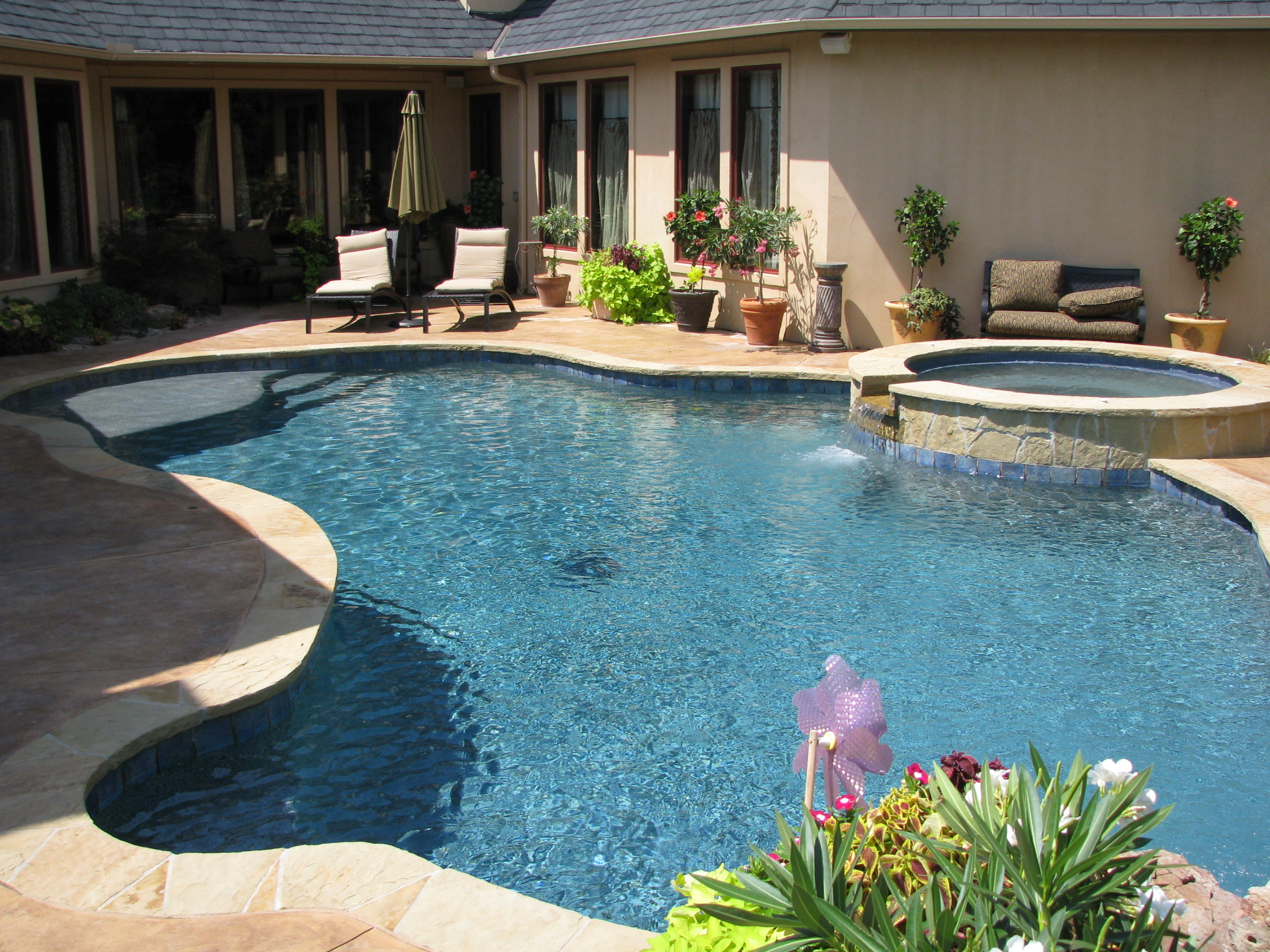 Free form pools blue haven pools tulsa Hot tubs tulsa