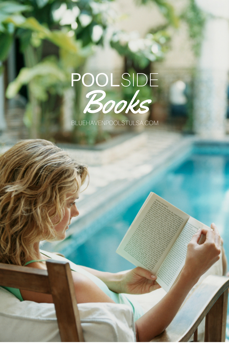 A woman reading a book by the pool
