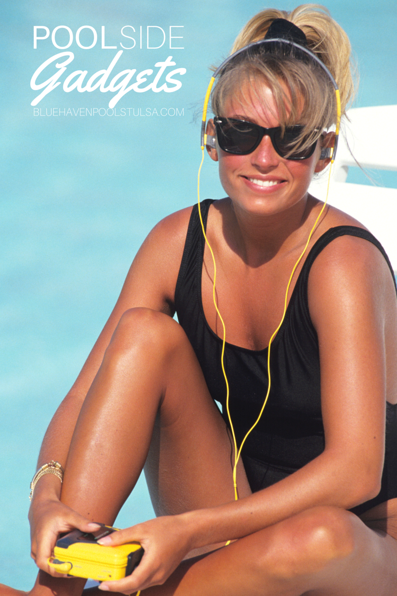 A woman with headphones in and a walkman is near a pool