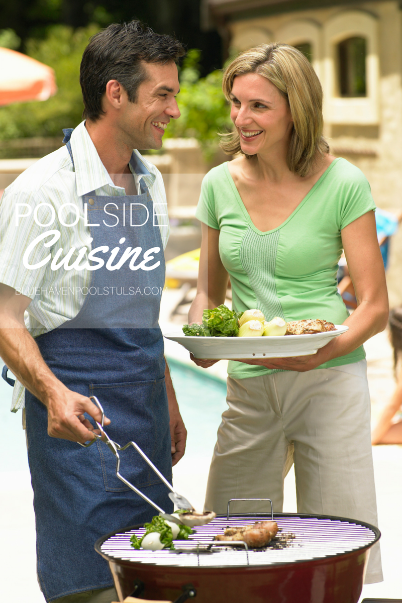A man and woman next to a grill cooking food