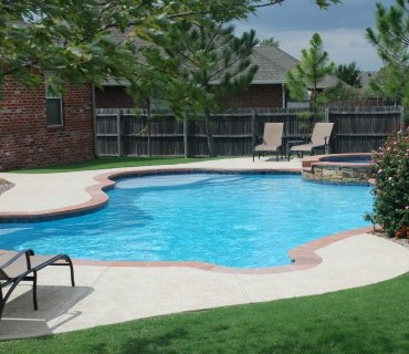 A broken Arrow Pool designed by Blue Haven Pools